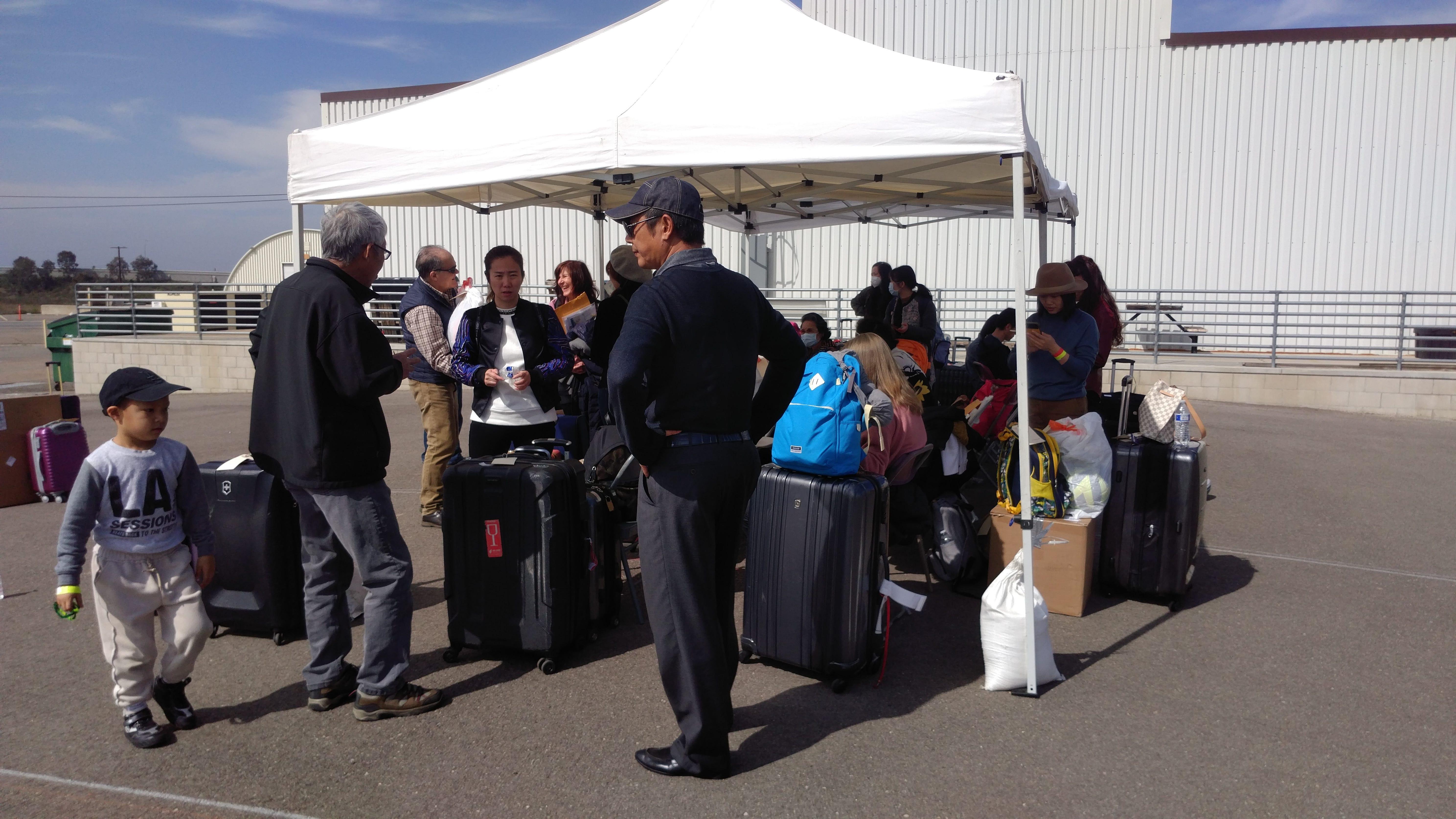 Evacuees at Marine Corps Air Station Miramar prepare to leave quarantine on Feb. 18, 2020.