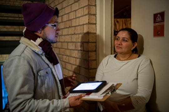 CASA canvasser Jonathan Hernandez explains the importance of the 2020 Census to Langley Park resident Maria Delmi Galdamez and asks her to pledge that her family will complete the census. Hernandez and others were out canvassing Jan. 23, 2020.