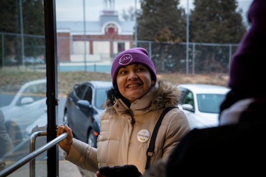 CASA canvasser Ligia Gomez of Takoma Park, MD., enters an apartment building to ask residents to pledge that they will fill out the 2020 census. Gomez and others went knocking on doors Jan. 23, 2020.