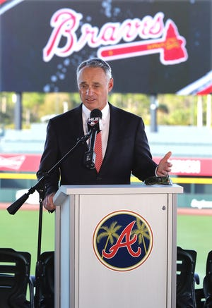 Rob Manfred takes questions during a Sunday press conference.