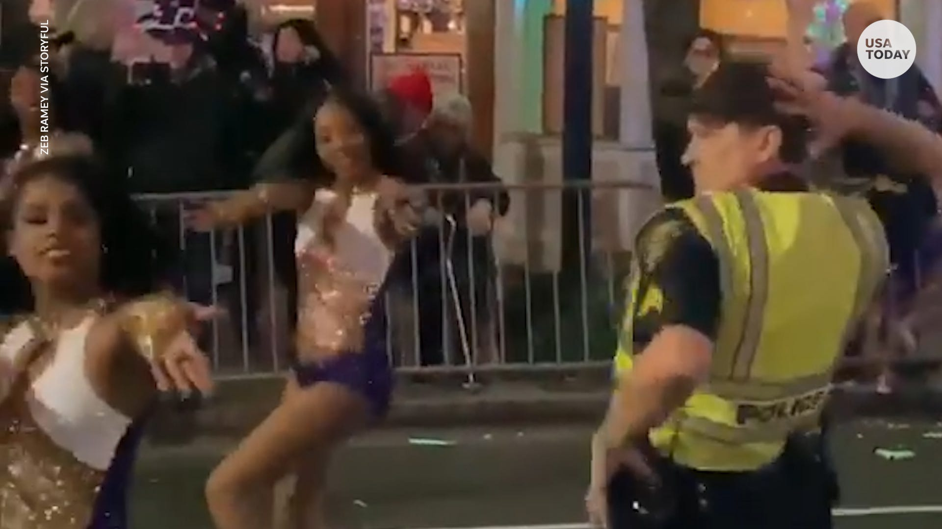 Cop busts a move with dancers during Mardi Gras parade in Alabama
