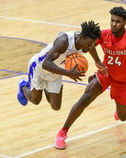 Wren senior Tez Frazier(15) is fouled by South Pointe guard Dwayne Moore during the fourth quarter of the Class AAAA Region III playoffs at Wren High School Wednesday. Wren won 56-55.