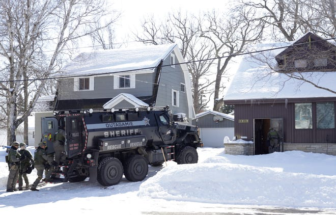 Police respond to a home on West Rogers Avenue on Thursday afternoon in Appleton.