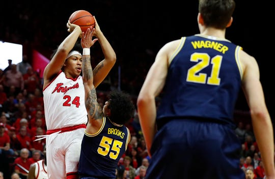 Feb 19, 2020; Piscataway, New Jersey, USA;  Rutgers Scarlet Knights guard Ron Harper Jr. (24) passes the ball against Michigan Wolverines guard Eli Brooks (55) during the second half at Rutgers Athletic Center (RAC).