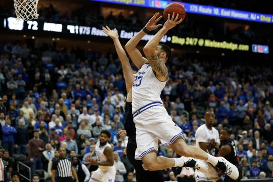 Seton Hall forward Sandro Mamukelashvili (23) goes up for two points to break a tie in the final second of an NCAA college basketball game Wednesday, Feb. 19, 2020, in Newark, N.J. Seton Hall won 74-72.  (AP Photo/Kathy Willens)