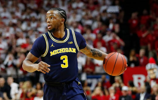 Feb 19, 2020; Piscataway, New Jersey, USA;  Michigan Wolverines guard Zavier Simpson (3) dribbles the ball against the Rutgers Scarlet Knights during the first half at Rutgers Athletic Center (RAC).