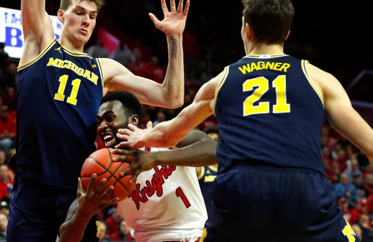 Feb 19, 2020; Piscataway, New Jersey, USA;  Michigan Wolverines forward Colin Castleton (11) and guard Franz Wagner (21) defend against Rutgers Scarlet Knights forward Akwasi Yeboah (1) during the second half at Rutgers Athletic Center (RAC).