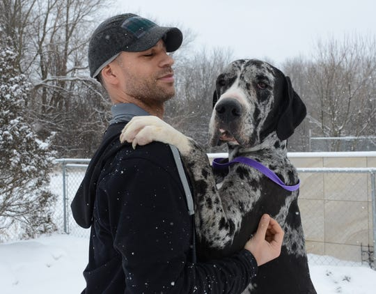 Tom Buford and the Great Dane found in a storage unit in Battle Creek.