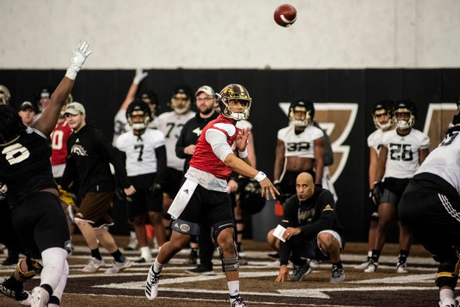 Western Michigan quarterback Kaleb Eleby (5) throws the ball during practice on Thursday, Feb. 20, 2020 at Donald Seelye Athletic Center in Kalamazoo, Mich.