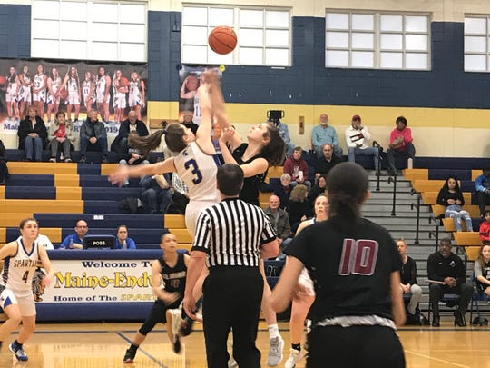Maine-Endwell's Sophia Pelton and Elmira's Megan Fedor rise on the opening tip for Wednesday's Southern Tier Athletic Conference semifinal at M-E. Elmira won, 85-71.