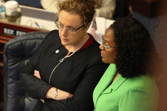 HB 265 co-sponsors Rep. Erin Grall, left, and Rep. Kimberly Daniels, talk among themselves as the House debates their bill which would require parental consent for abortion at the Capitol Thursday, Feb, 20, 2020.