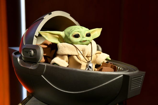 """The Child,"" sometimes referred to as ""Baby Yoda,"" is featured in a number of new toys and items revealed at the Star Wars New York Toy Fair Product Showcase on Feb. 20, 2020 in New York City."