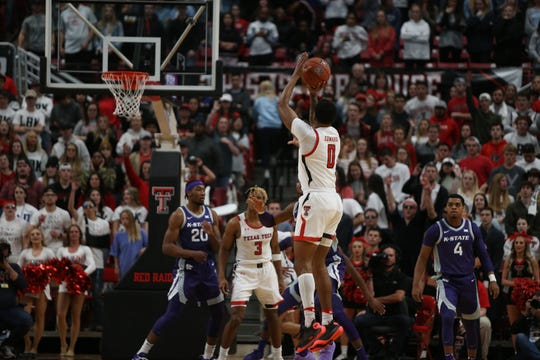 Feb 19, 2020; Lubbock, Texas, USA;  Texas Tech Red Raiders guard Kyler Edwards (0) takes a shot in front of Kansas State Wildcats forward Montavious Murphy (23) in the first half at United Supermarkets Arena. Mandatory Credit: Michael C. Johnson-USA TODAY Sports