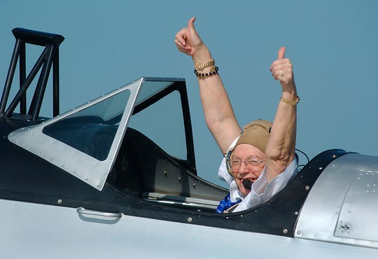 Maxine Flournoy gives thumbs up to a group of onlookers as taxied to the runway at NAS Kingsville in a C.A.F. PT-19 flown by Dan Duewall on May 21, 2004 as she relived her experiences during WWII as a WASP, Women Airforce Service Pilots.
