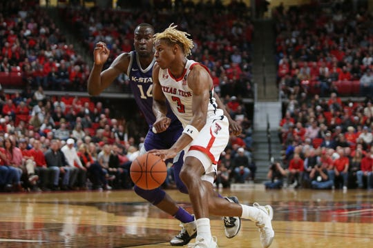 Feb 19, 2020; Lubbock, Texas, USA;  Texas Tech Red Raiders guard Jahmi'us Ramsey (3) works the ball against Kansas State Wildcats forward Makes Mawien (14) in the first half at United Supermarkets Arena. Mandatory Credit: Michael C. Johnson-USA TODAY Sports