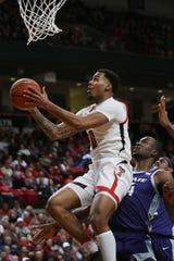 Feb 19, 2020; Lubbock, Texas, USA;  Texas Tech Red Raiders guard Kyler Edwards (0) goes to the basket against Kansas State Wildcats forward Makes Mawien (14) in the first half at United Supermarkets Arena. Mandatory Credit: Michael C. Johnson-USA TODAY Sports