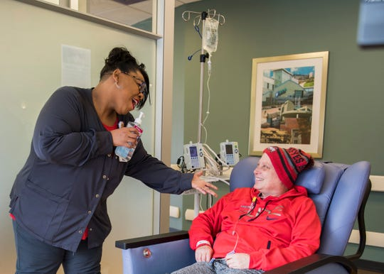 Billie Sanyang entertains Deanna, a cancer patient at Adena, and was nominated for her boisterous personality and tries to be a light to patients in a very challenging part of their lives and believes that laughter is good for the soul.