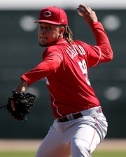Cincinnati Reds starting pitcher Luis Castillo (58) throws during live batting practice, Thursday, Feb. 20, 2020, at the baseball team's spring training facility in Goodyear, Ariz.