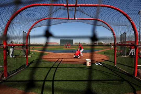 Cincinnati Reds non-roster invitee infielder Derek Dietrich (35) hits during live batting practice, Wednesday, Feb. 19, 2020, at the baseball team's spring training facility in Goodyear, Ariz.