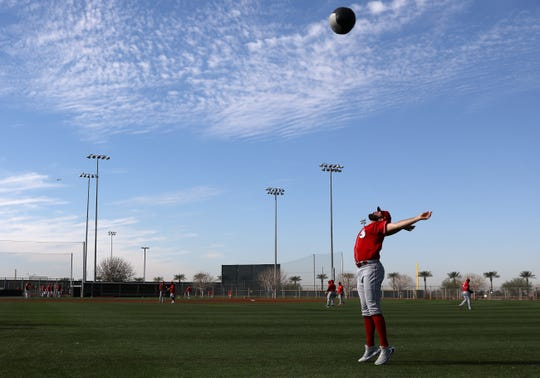 Cincinnati Reds starting pitcher Tejay Antone (70) throws a an exercise ball in the air, Wednesday, Feb. 19, 2020, at the baseball team's spring training facility in Goodyear, Ariz.