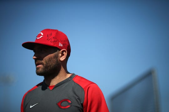 Cincinnati Reds first baseman Joey Votto (19) honored late baseball player Tony Fernandez with a messaged on his hate, Wednesday, Feb. 19, 2020, at the baseball team's spring training facility in Goodyear, Ariz.