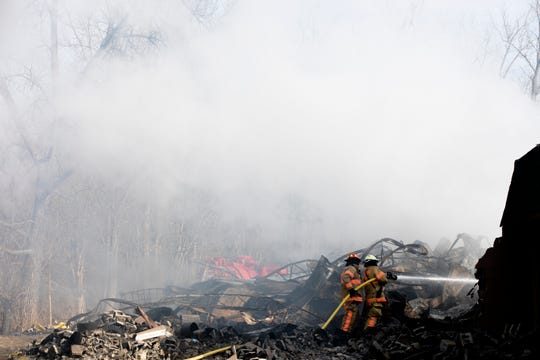 Morgan Township Firefighters continued to monitor a fire on Thursday  the Wholesale Tire Mart, 4954 Alert New London Road in Butler County. The fire started around 7 p.m. on Tuesday and fire officials said it was active for 26 hours.