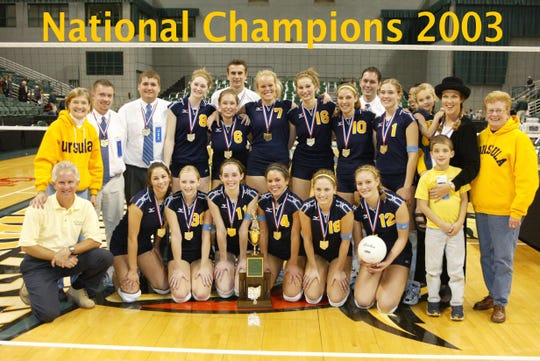 The 2003 state and national champion St. Ursula Academy volleyball team and supporters included, from left: Front, athletic director Mike Sipes, Natalie Kuhn Sebald, Erin Schroeder Julkowski, Beth Gillming Kamen, Tricia Cronin Livingston, Stephanie Wessels, Beth Shelton Hountz, Jim Perry (son of Julie Perry; back, principal Fran Romweber, assistant coach Kevin Lucas, assistant coach Don Zeller, Mackenzie Angner, Molly Slepitza Leeds, Zoran Dragovic, Michelle Kenning, Maggie Schmelzle Glacken, Meghan Mooney Jacobsen,  assistant coach Bill Ferris, Bryn Kehoe Eaton, assistant coach Kim McCullum, Catherine Perry (daughter of Julie Perry), head coach Julie Perry and principal Judith Wimberg