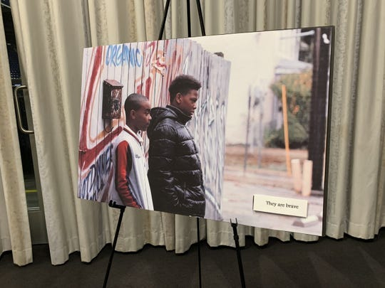 """Artwork displayed at the premiere of the """"Shoot This Not That"""" documentary at Xavier University's Cintas Center in January."""