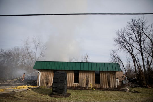 Morgan Township Firefighters continue to monitor a fire on Thursday Feb. 20, 2020, that burned the Wholesale Tire Mart at 4954 Alert New London Road in Butler County. The fire started around 7 p.m. on Tuesday, Feb. 18, 2020.