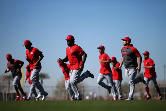 Cincinnati Reds position players run to warm up during spring practice, Thursday, Feb. 20, 2020, at the baseball team's spring training facility in Goodyear, Ariz.