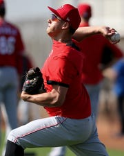 Cincinnati Reds relief pitcher Robert Stephenson (55) throws during drills, Wednesday, Feb. 19, 2020, at the baseball team's spring training facility in Goodyear, Ariz.
