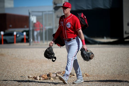 Cincinnati Reds catcher Tyler Stephenson (71) carries his equipment to the field during spring practice, Thursday, Feb. 20, 2020, at the baseball team's spring training facility in Goodyear, Ariz.