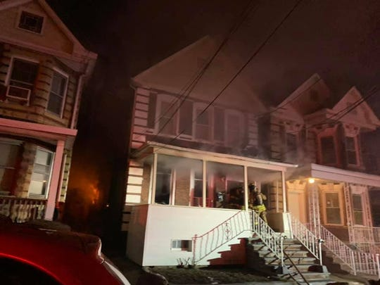 Two residents suffered smoke inhalation from the Lawrie Street fire in Perth Amboy Thursday morning.