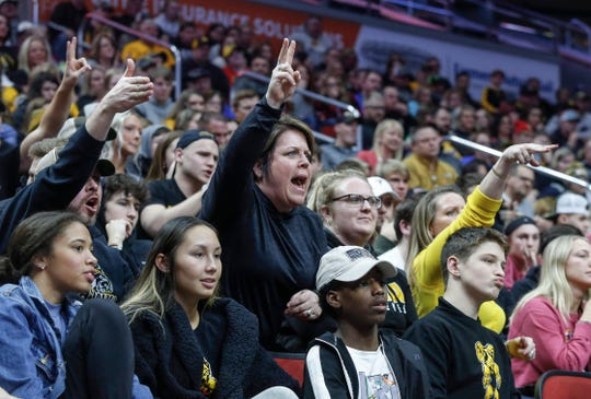 Southeast Polk fans react to a takedown in a match against Waverly-Shell Rock during the 2020 Iowa high school wrestling dual state tournament at Wells Fargo Arena in Des Moines on Wednesday, Feb. 19, 2020.