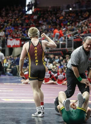 Ankeny senior Sam Kallem celebrates after pinning Cedar Rapids Kennedy senior Dylan Falck in their match at 145 pounds during the 2020 Iowa high school state wrestling tournament at Wells Fargo Arena in Des Moines on Thursday, Feb. 20, 2020.
