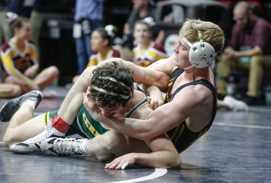 Ankeny senior Sam Kallem works on Cedar Rapids Kennedy senior Dylan Falck in their match at 145 pounds during the 2020 Iowa high school state wrestling tournament at Wells Fargo Arena in Des Moines on Thursday, Feb. 20, 2020.