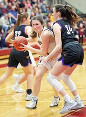 Ankeny senior Isabelle Vacek (35) works past Johnston freshman Emma Hampton (34) as the Johnston Dragons compete against the Ankeny Hawkettes in high school girls' basketball on Friday, February 14, 2020 at Ankeny High School. The Dragons won 76 to 38.
