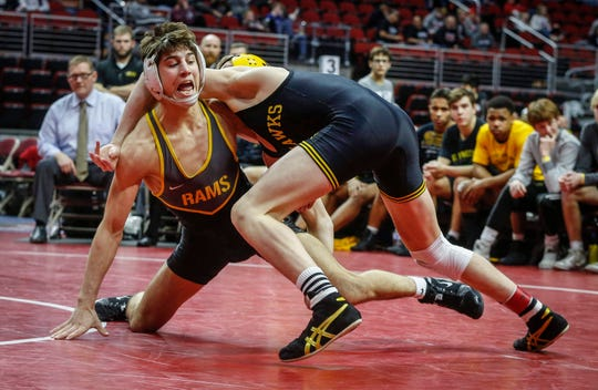 Southeast Polk's Joel Jesuroga tries to break out of the hold of Waverly-Shell Rock's Aiden Riggins in their match at 1323 pounds during the 2020 Iowa high school wrestling dual state tournament at Wells Fargo Arena in Des Moines on Wednesday, Feb. 19, 2020.