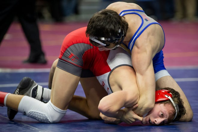 Colby Lillegard of Bondurant-Farrar, blue, wrestles, Brock Moore of Forest City, red, during their first round 2A match at Wells Fargo Arena on Thursday, Feb. 20, 2020, in Des Moines. Lillegard would go on to win by a 9-3 decision.