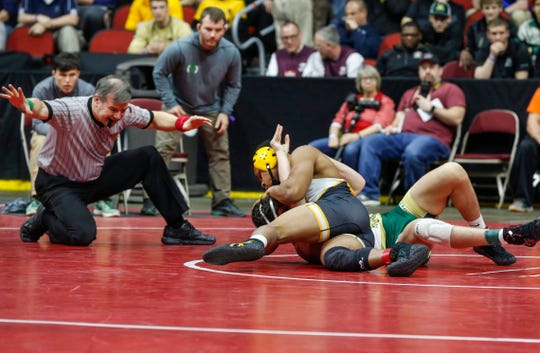 Southeast Polk senior Deveyon Montgomery pins Iowa City West junior Ashton Barker in their match at 170 pounds during the 2020 Iowa high school state wrestling tournament at Wells Fargo Arena in Des Moines on Thursday, Feb. 20, 2020.