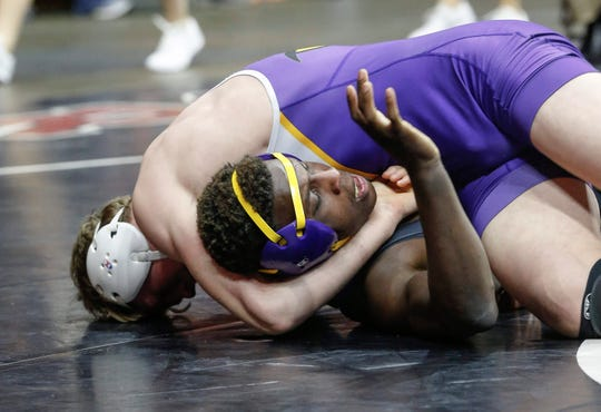 Johnston junior Caleb Helgeson pins Cedar Rapids Washington's Jermaine Sammler in their match at 160 pounds during the 2020 Iowa high school state wrestling tournament at Wells Fargo Arena in Des Moines on Thursday, Feb. 20, 2020. Johnston placed eighth in the tournament with 66.5 points.