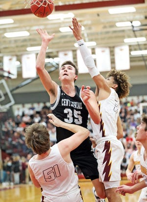 Ankeny Centennial senior and Wayne State commit Cody McCullough (35) shoots for two as the No. 3 Ankeny Centennial Jaguars compete against the No. 9 Ankeny Hawks in high school boys' basketball on Friday, February 7, 2020 at Ankeny High School. The Jaguars won 50 to 48.