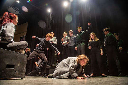 Isabella Ksiazak falls to the ground as her character, the elephant Baby Mine, is whipped as students in Valley High School's Readers Theater group rehearse a production of the story of Baby Mine, the Iowa State Fair elephant Wednesday, Feb. 19, 2020.