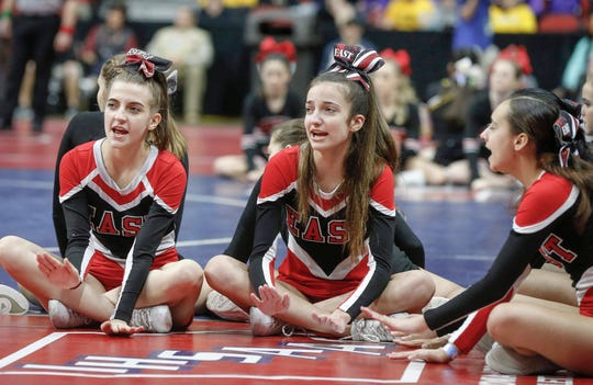 Members of the Des Moines East wrestling cheerleading team perform mat-side during the 2020 Iowa high school state wrestling tournament at Wells Fargo Arena in Des Moines on Thursday, Feb. 20, 2020.