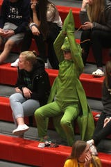 A Norwalk fan dressed as a praying mantis to cheer on the Warriors. Carlisle edged Norwalk 34-40 in the first round of the Class 4A playoffs Feb. 19, 2020 in Carlisle.