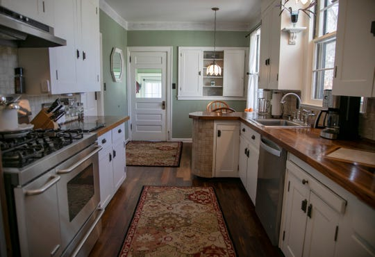 This unique mid-1800's farmhouse in Franklin features Eastlake Victorian hardware, updated kitchen with walnut counters with marble inlay for heated pots. The house was photographed Wednesday, Feb. 19, 2020.