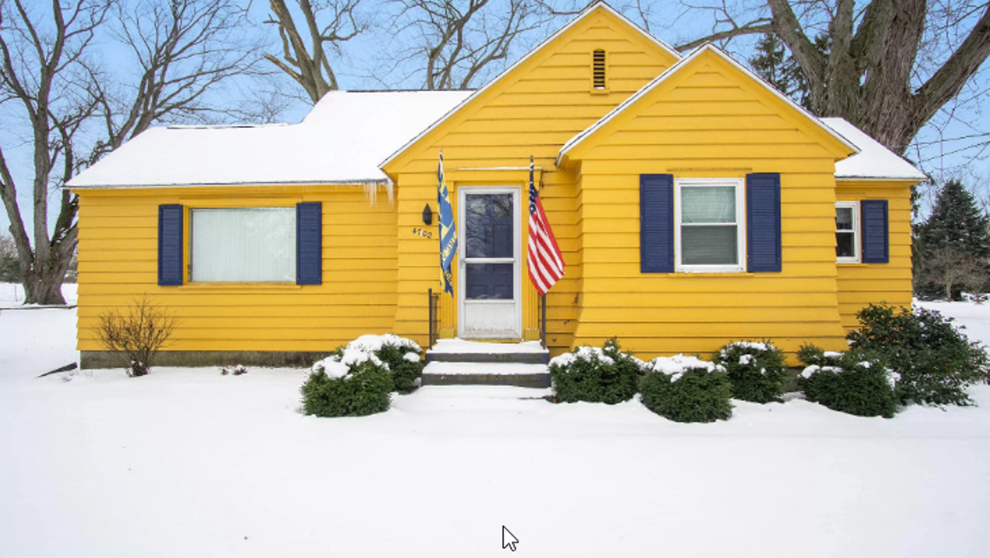 Home completely decked out in University of Michigan gear hits market for $169,000