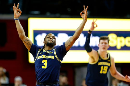 Michigan guard Zavier Simpson reacts after making a 3-pointer against Rutgers during the first half Wednesday, Feb. 19, 2020 in Piscataway, N.J.