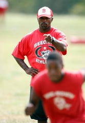 Flint Beecher coach Courtney Hawkins watches drills August 30, 2010.