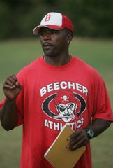 Flint Beecher football coach Courtney Hawkins  was hired to coach wide receivers at Michigan State, his alma mater.